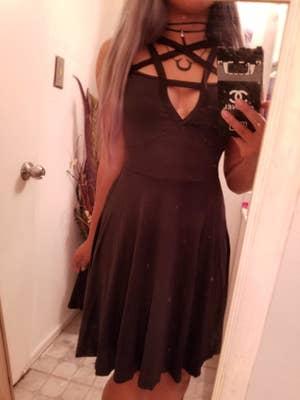reviewer wearing the pentagram dress