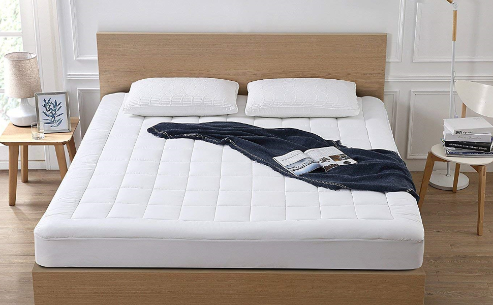 The oaskys mattress pad on a bed