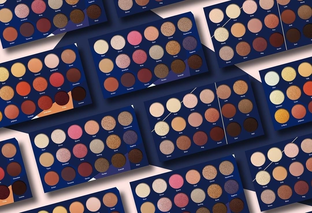 Several Jacob & Eli eyeshadow palettes laid out
