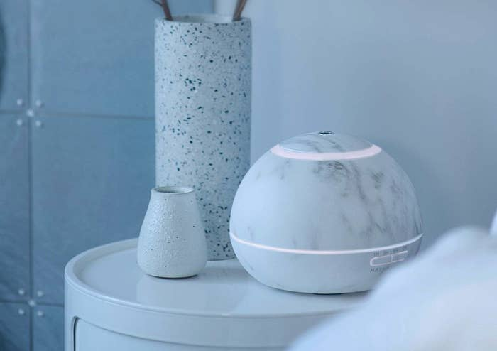 The Hathaspace Marble Essential Oil Aroma Diffuser in a bedroom