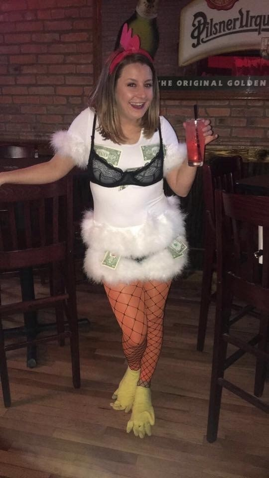 A woman dressed as a chicken with fishnet tights, a bra, and money coming out of them