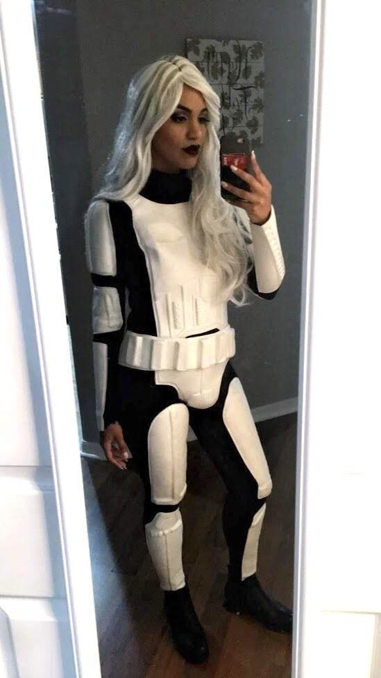 A woman in a stormtrooper suit with hair like Storm from X-Men