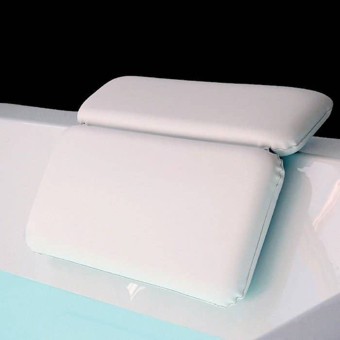 A two-fold pillow attached to the rim of the bath tub