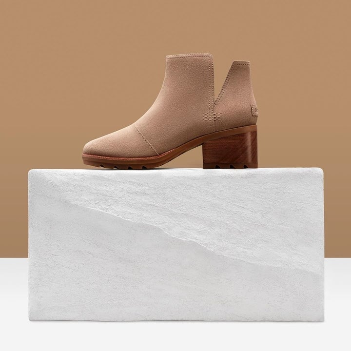 a tan shoe with a stacked block heel