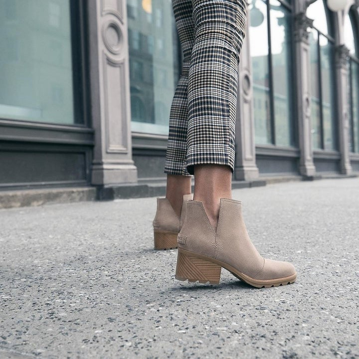 a model in the shoes on a sidewalk