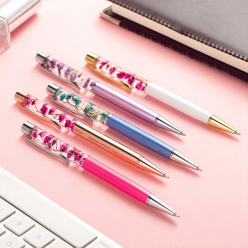 pens with liquid chambers with floating flowers