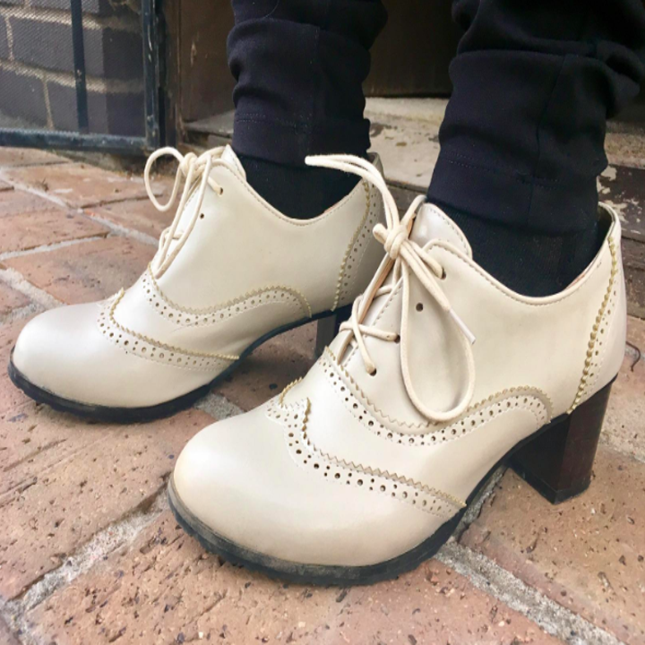 A reviewer wearing them in off-white