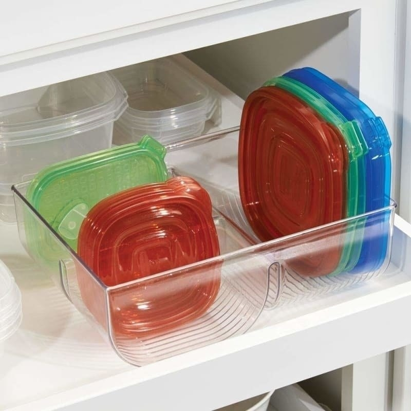 clear container with three different sized compartments with plastic lids in each