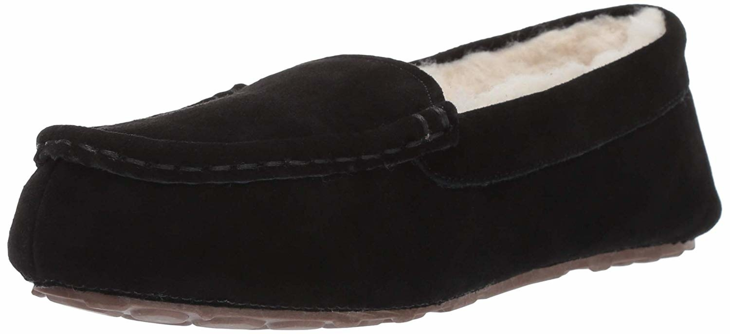 A black pair of moccasins with wool on the inside