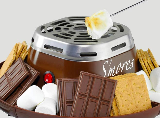 Small heater with bowl sides to fill with chocolate, marshmallows, and crackers