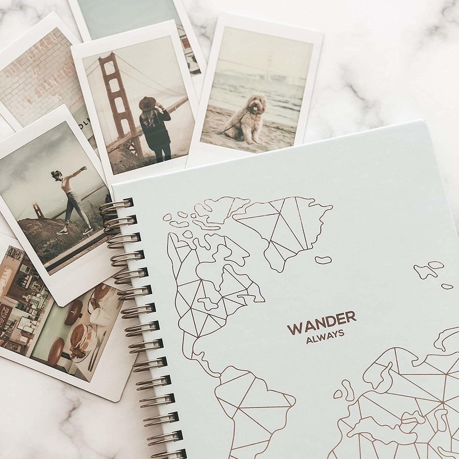 """the blue spiral notebook labeled """"Wander Always"""""""