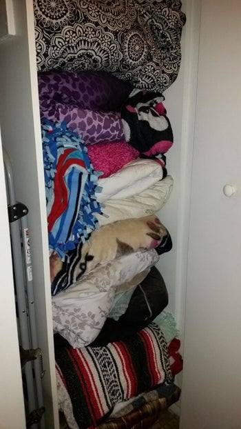 A reviewer's cramped closet before using the storage bags