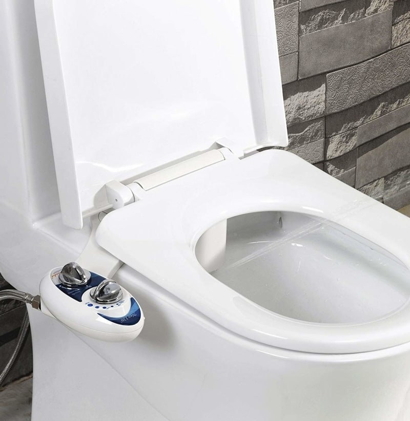 bidet attachment on toilet with control knobs on the side