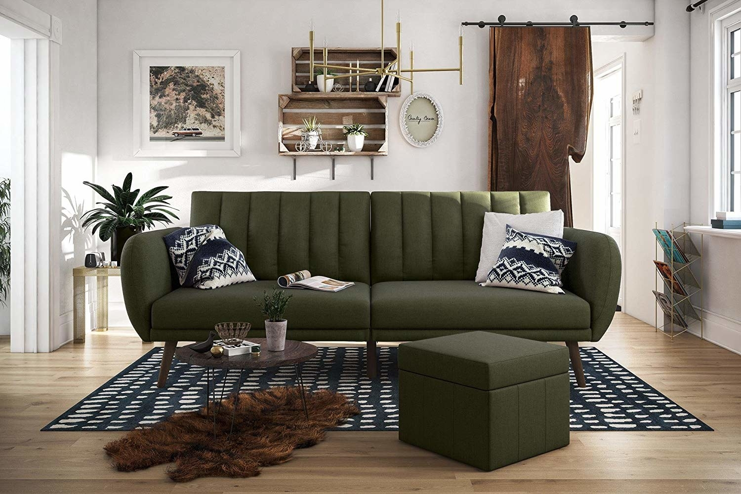 The tufted-back futon with large arms and wood feet in a living room