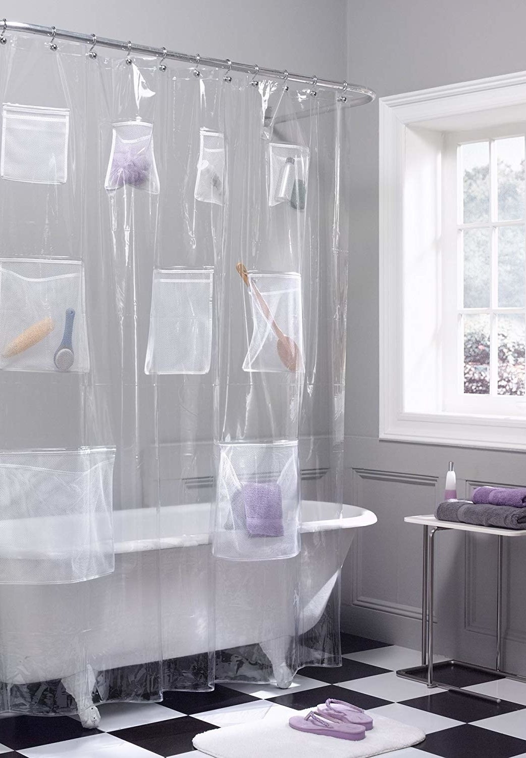 The clear shower liner with items in most pockets