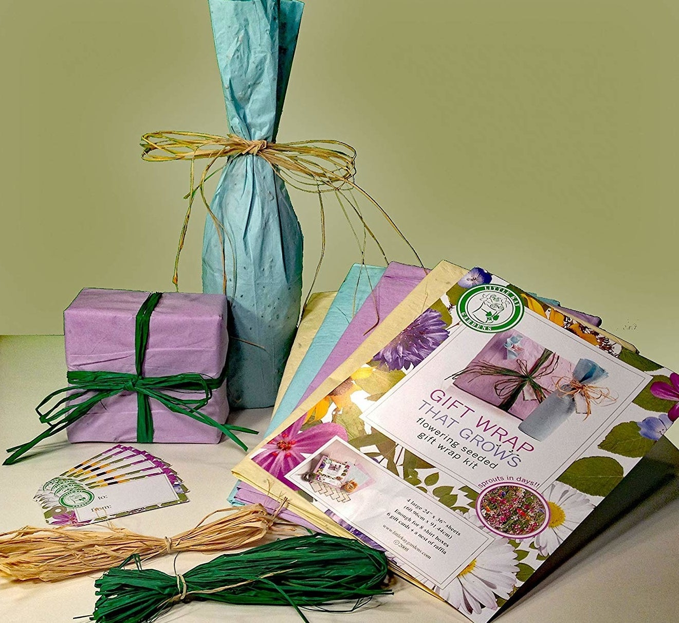 The gift wrap set with sheets in purple, yellow, and green as well as raffia in yellow and green