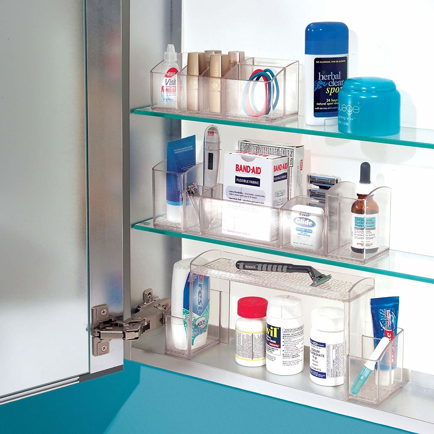 The organizer being used in a medicine cabinet