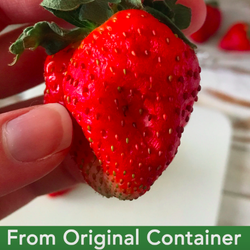 A BuzzFeed editor's photo of a wilted strawberry kept in a regular container