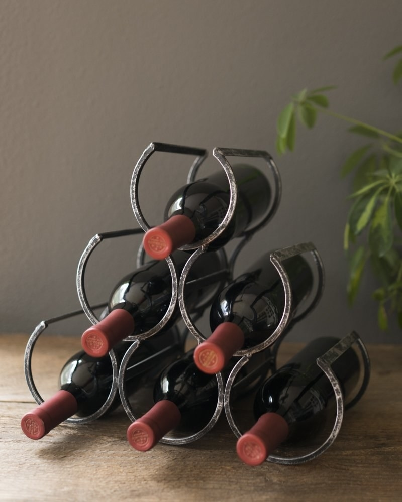 Six wine bottles in the wine rack