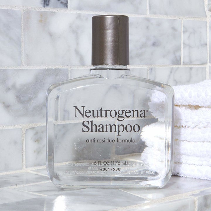 The clear bottle of shampoo