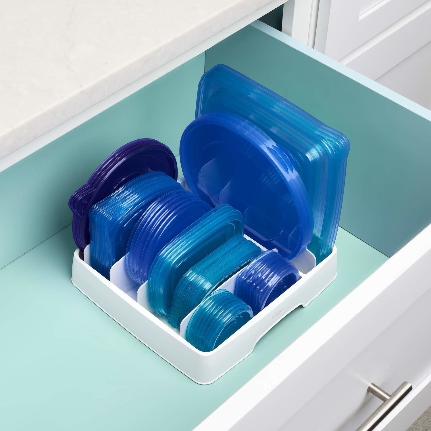 A bunch of plastic lids organized by size in the container lid organizer