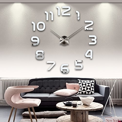 A 3D wall clock hanging above a sofa in the living room.