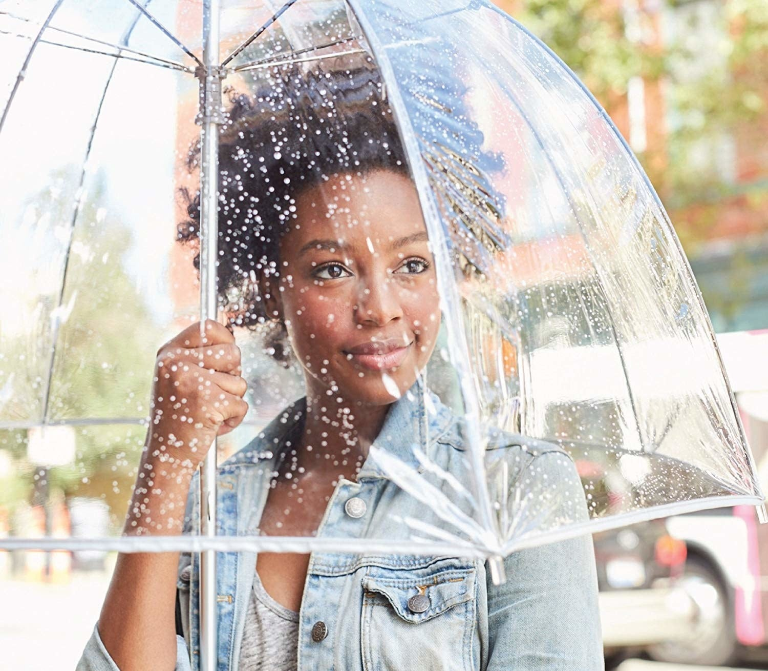 A model in the umbrella that comes down slightly below their shoulders