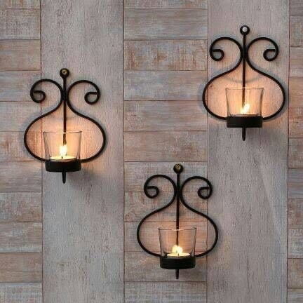 Wall sconces lit up while hanging on a wall.