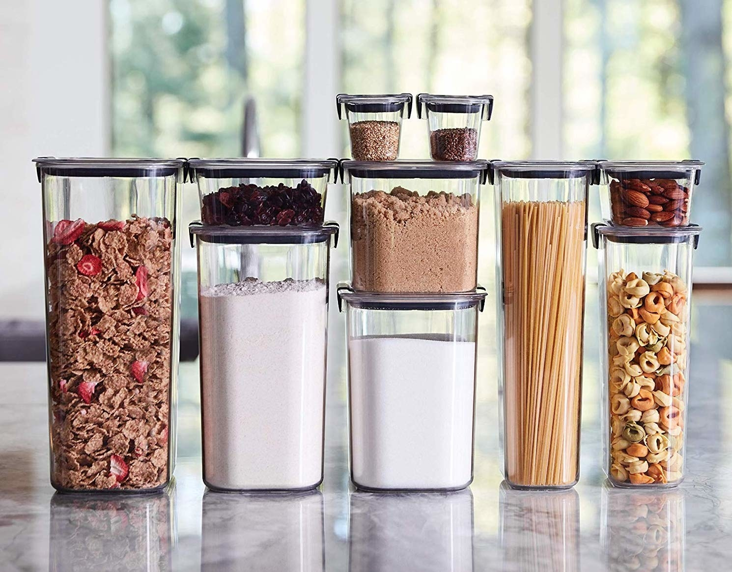 Several airtight storage containers filled with pantry staples