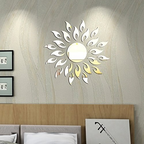 A reflective sun-shaped wall sticker attached to a wall.