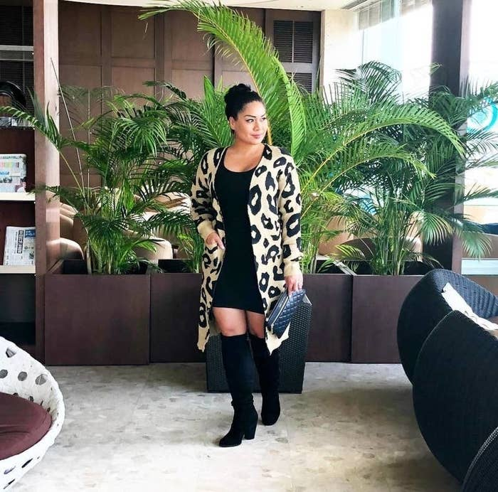 Reviewer wearing the open-front cardigan in light brown with black leopard print