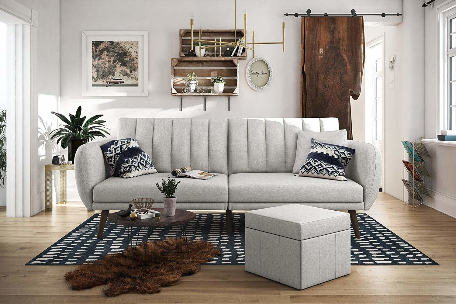 the futon with tufted back in light grey