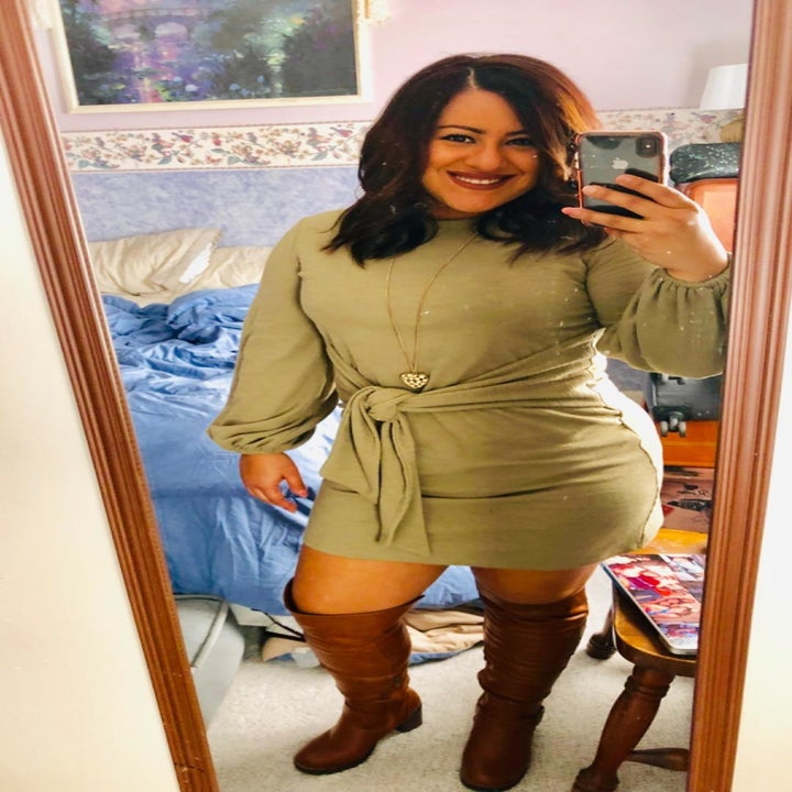 another reviewer wearing the dress in sage green