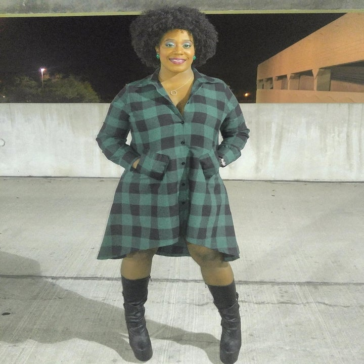 Reviewer wearing the high-low shirtdress in green plaid with their hands in the pockets