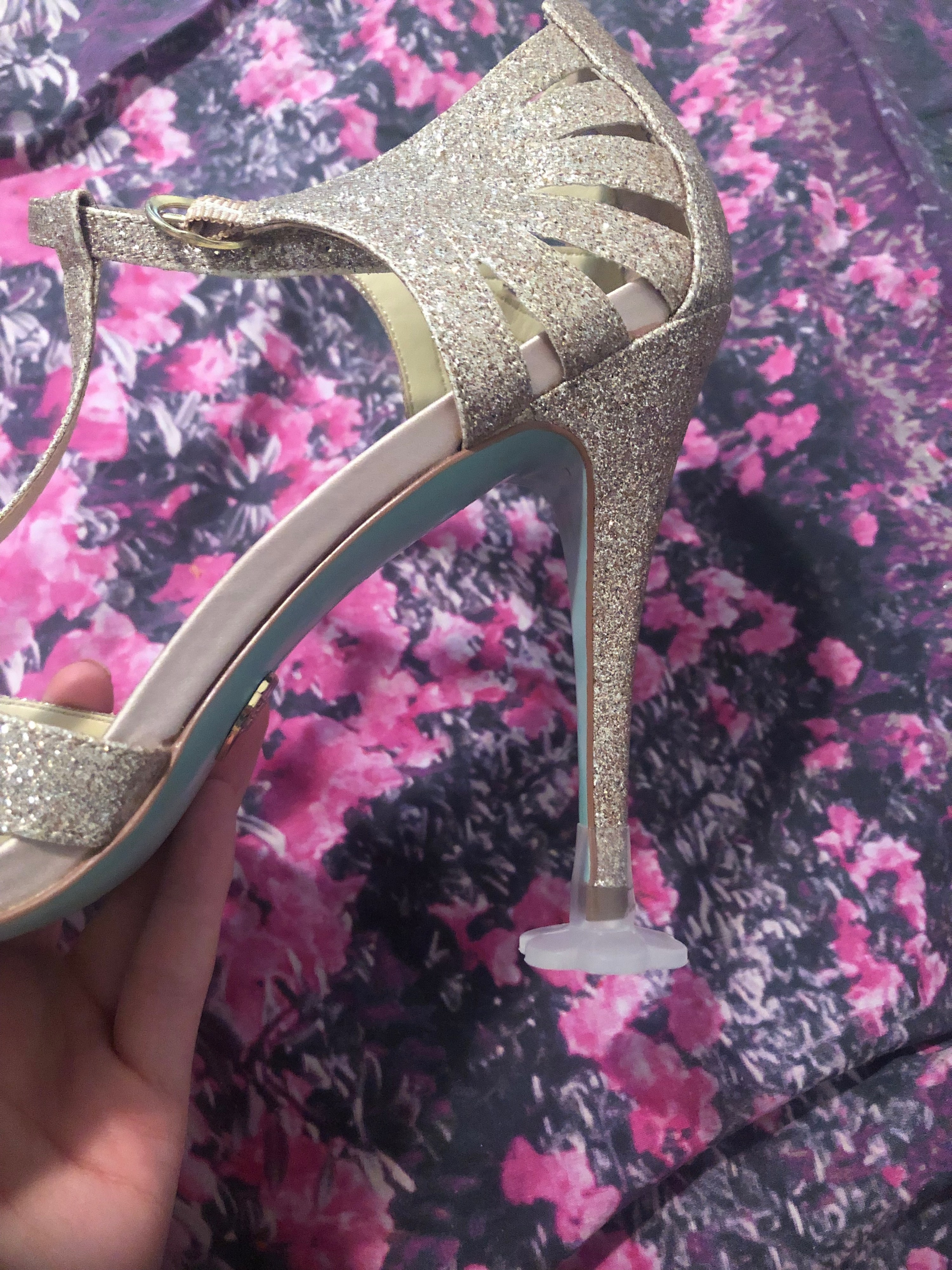 BuzzFeed editor Elizabeth Lilly's wedding heel with a heel stoppers on the bottom that offers a clear, circular landing for her shoe