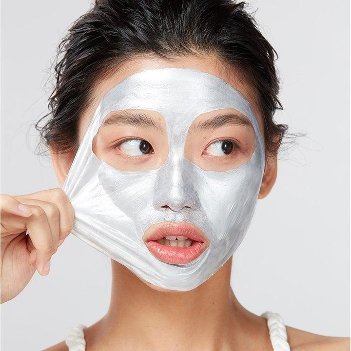 model peels off shiny face