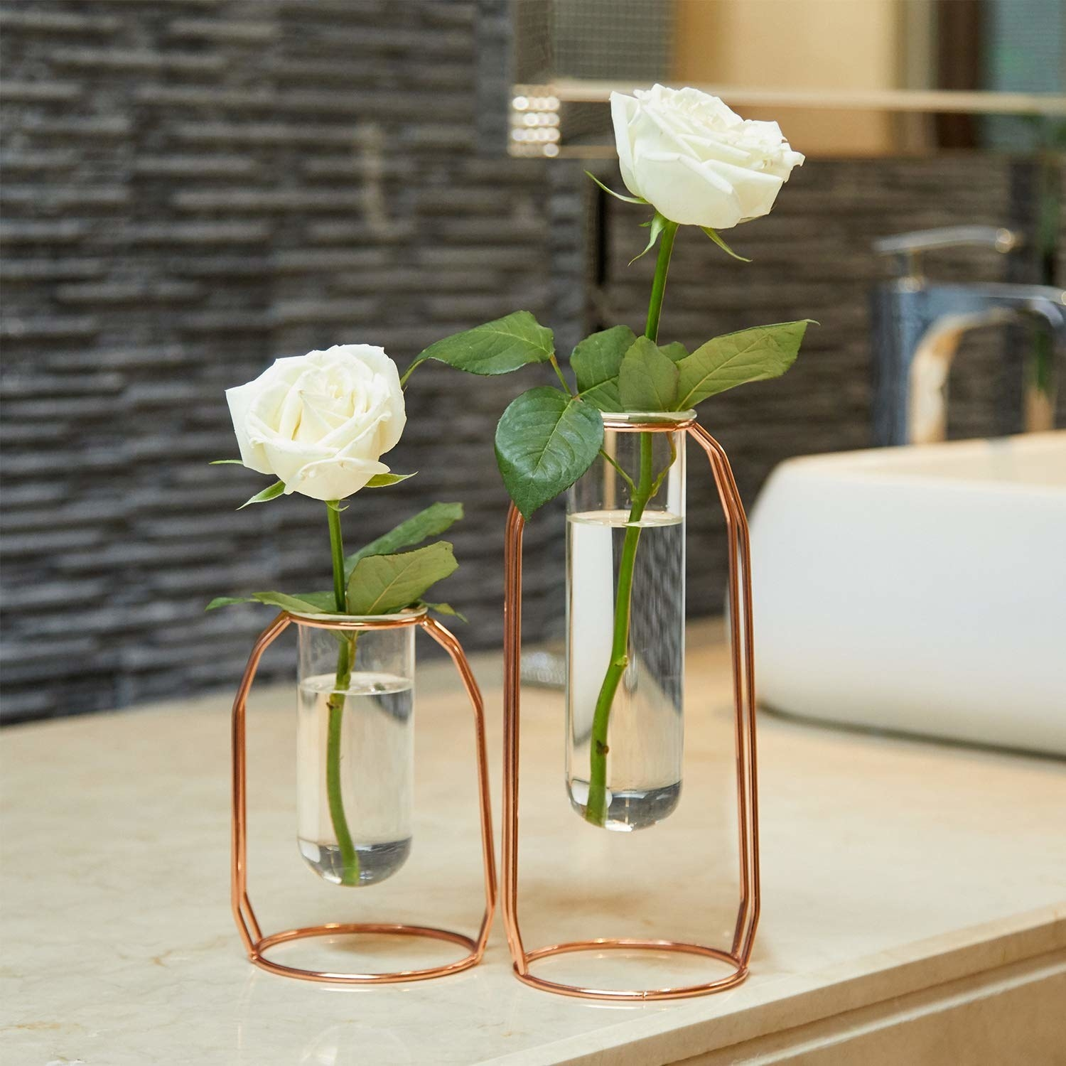 glass beakers held in metal vase