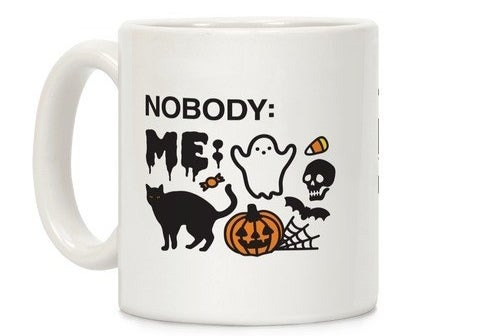 """A white mug that references a meme and says, """"nobody:"""" and the line is blank and then says, """"me:"""" next to spooky-themed emojis"""