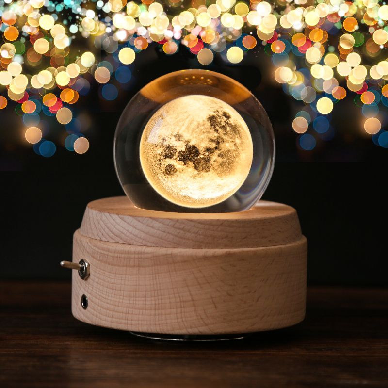 wood base with clear glass sphere and moon inside