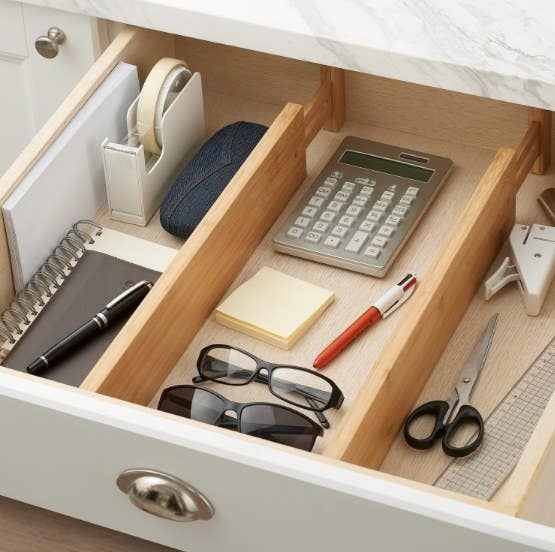 the bamboo divider separating various items in a drawer