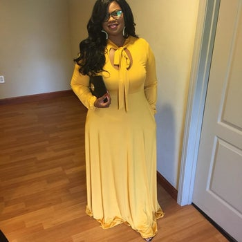 Reviewer wearing the long-sleeved dress in yellow