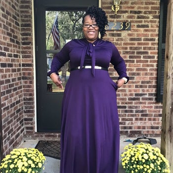 A different reviewer wearing the dress in purple with a belt