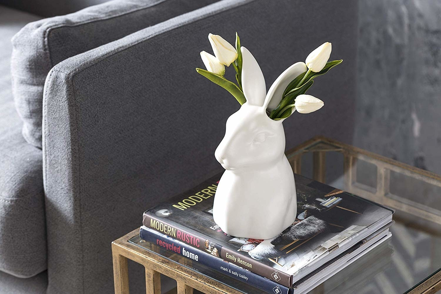 White rabbit-shaped planter with flowers coming out of either ear