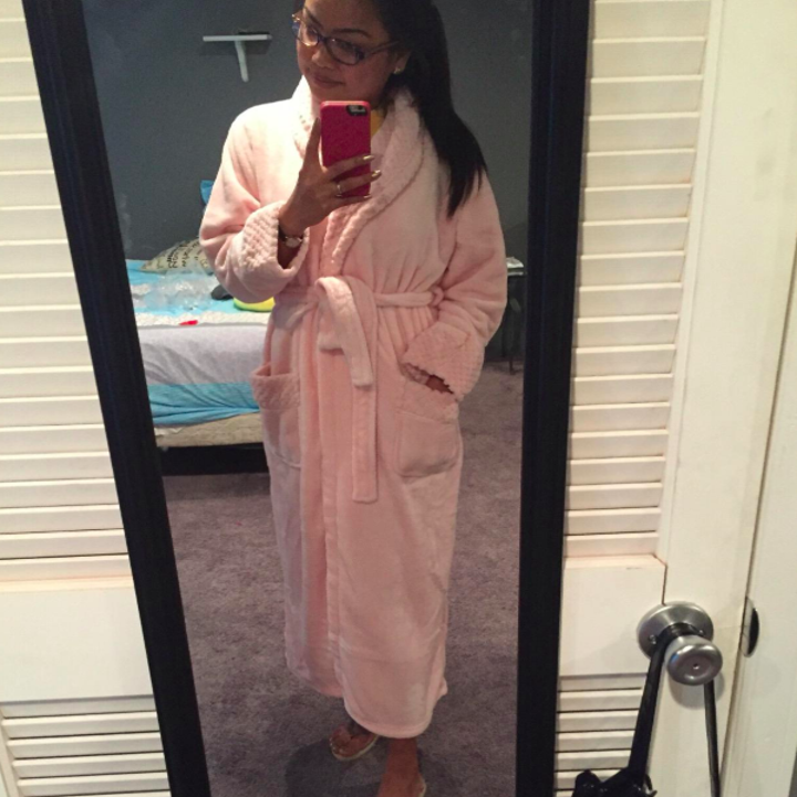 reviewer in a pink robe
