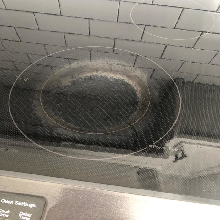 Reviewer's ceramic stovetop with stains on it