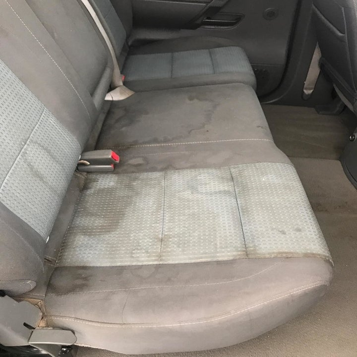 Reviewer's photo of a car seat covered in stains