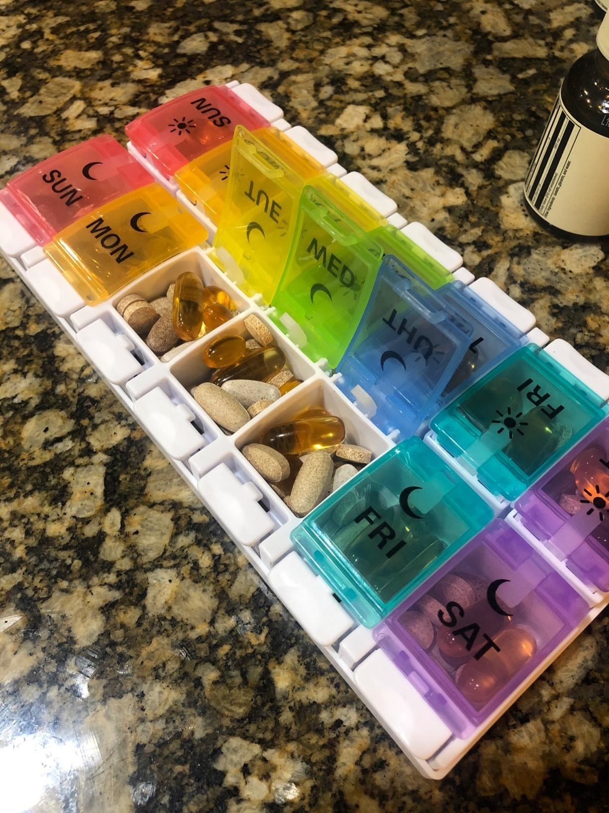 a pill organizer filled with various medications