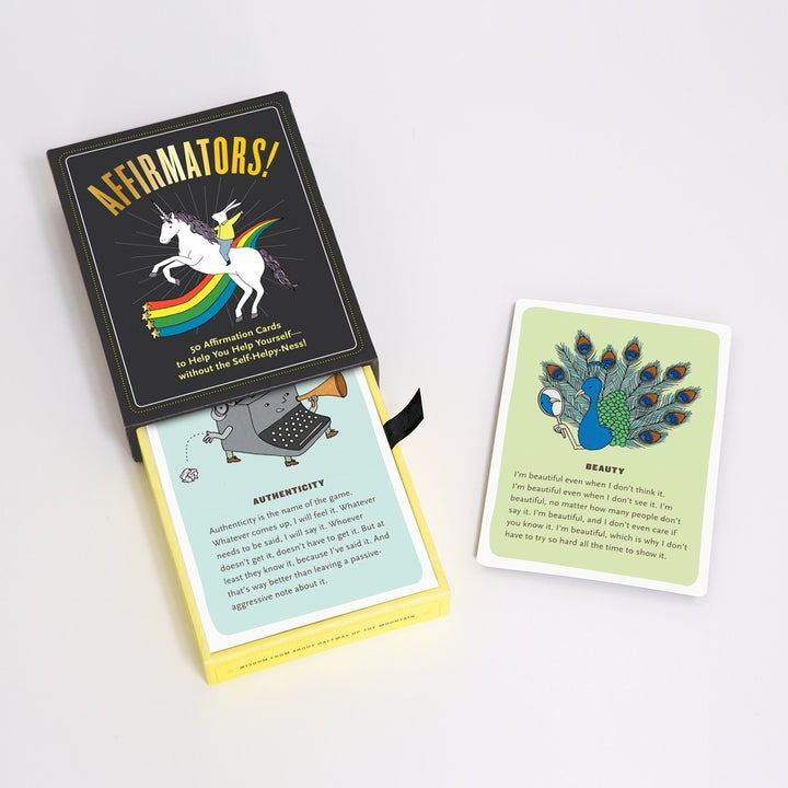 a deck of affirmation cards displayed next to its original packaging