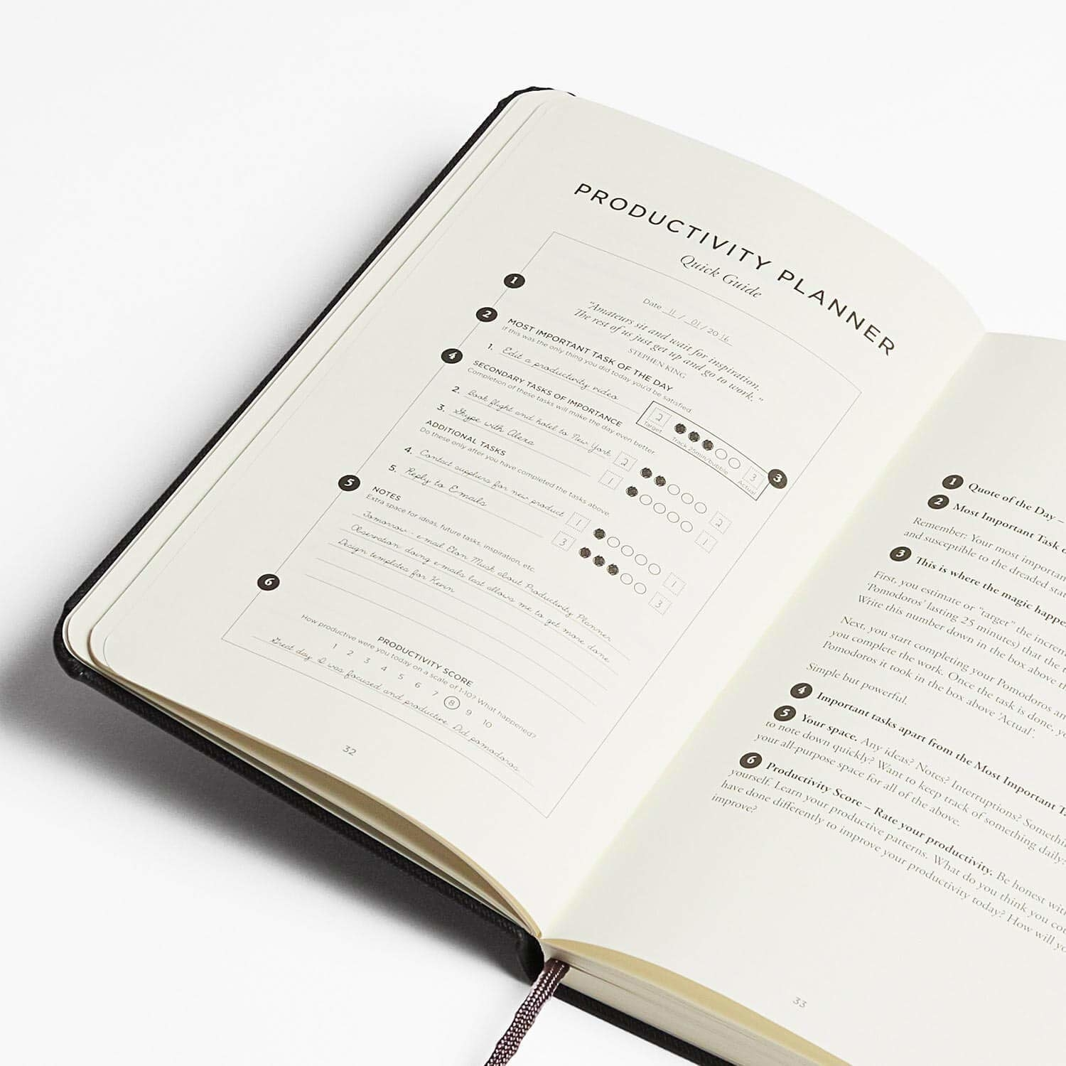 an open productivity planner with one of its pages on display