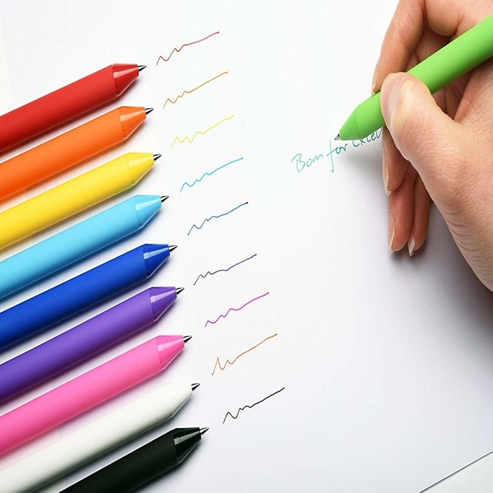 a green gel pen being used near the rest of the pack